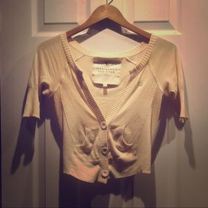 Lightweight cream-colored shrug